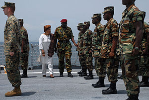 Armed Forces of Liberia - President Ellen Johnson Sirleaf inspecting AFL soldiers on board USS ''Fort McHenry'' in 2008