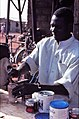 ASC Leiden - W.E.A. van Beek Collection - Dogon markets 05 - Coffee bar keeper, Sangha market, Mali 1992.jpg