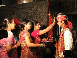 Tilaka - A Tilaka ceremony in progress to welcome the groom at a Hindu wedding.