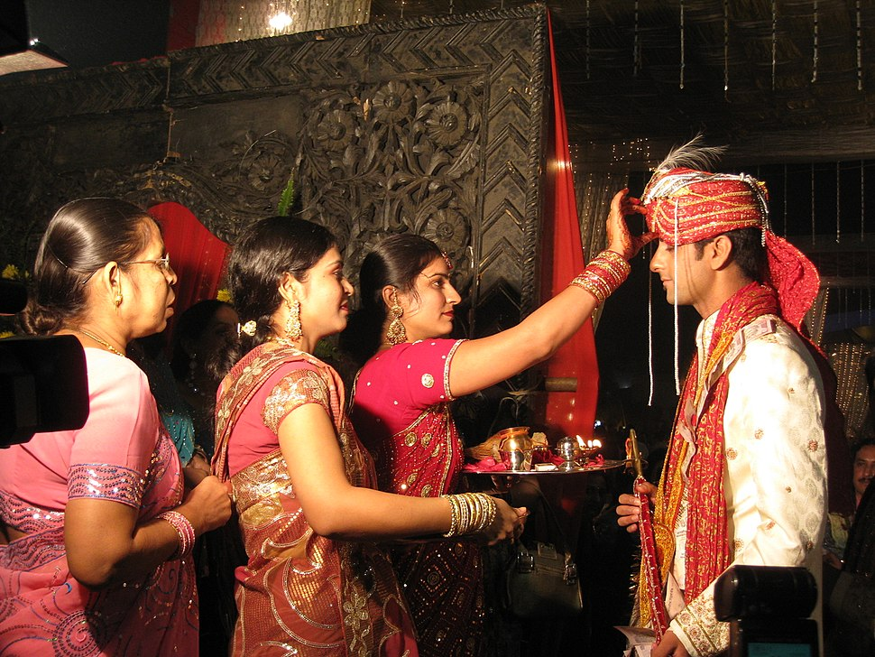 A Hindu wedding ritual in progress b