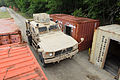 A Master Driver with the 174th Infantry Brigade drives a mine-resistant, ambush-protected (MRAP) vehicle through closely-spaced shipping containers at the revamped drivers training course July 13, 2012, at Joint 120713-A-SR132-245.jpg