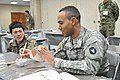 A U.S. Soldier, right, with the 34th Infantry Division, Minnesota Army National Guard hand paints a mug as a Japanese soldier watches 120123-A-OX951-030.jpg