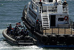 A VBSS team boards a tugboat during a training assessment..jpg