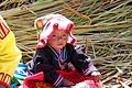 A child dressed in traditional Uros style, Lake Titicaca Peru.jpg