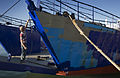 A dock worker painting a ship's hull, Auckland - 0294.jpg