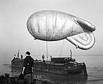 A kite balloon tethered to the balloon barge NORMAN WADE on the River Humber, at No. 17 Balloon Centre at Sutton-on-Hull in Yorkshire, January 1943. CH8663.jpg