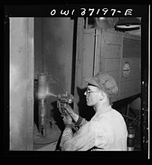 A mechanic metalizing a part in the machine shop at the Greyhound garage. 8d32925v.jpg