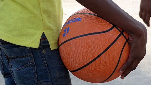 A person holding basket ball in his hand.JPG