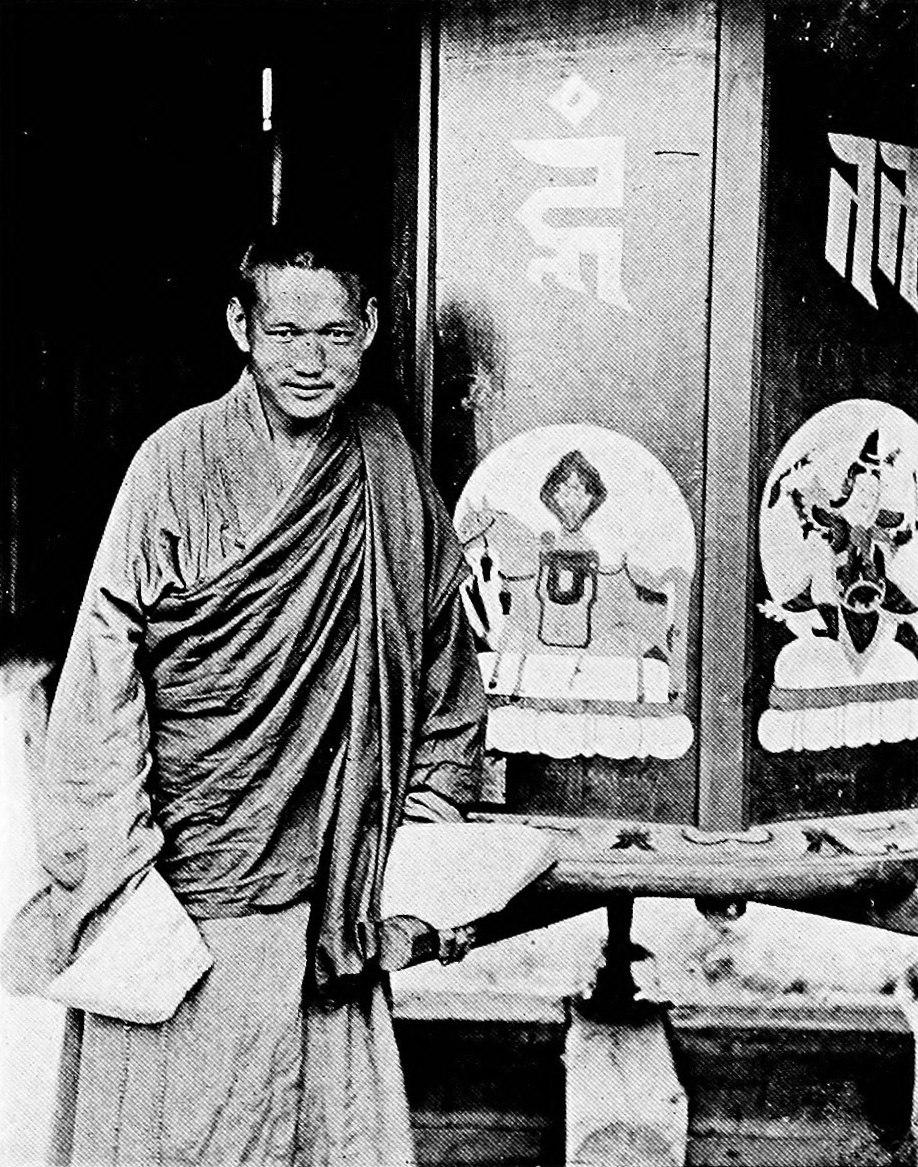A prayer wheel and a mongol lama