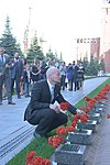 Alexander Gerst lays flowers where Russian space icons are interred.jpg