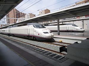 Alicante railway station - Two AVE Class 100 trains at the Alicante terminal.