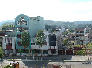 Maluku sectarian conflict - Damage to Ambon City in 2001. Apartments fortified with sandbags can be seen in foreground.