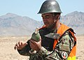 An Afghan National Army mortar instructor prepares an 82 MM Russian Mortar (4705394107).jpg