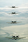 An air-to-air front view of four 25th Tactical Fighter Squadron A-10 Thunderbolt II aircraft in formation during Exercise Team Spirit '86 DF-ST-87-09802.jpg