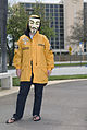 Anon protester with Volunteer Ministers jacket.jpg