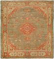Antique oushak carpet with a pale red and green tone.jpg