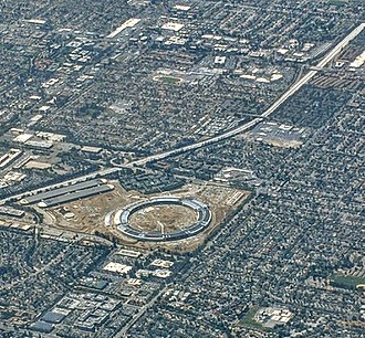 Apple Park - Apple Park satellite view during construction in May 2017. The original Apple Campus is visible near the top.