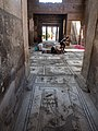 Archaeologists excavating inside building in Pompeii, 2016.jpg