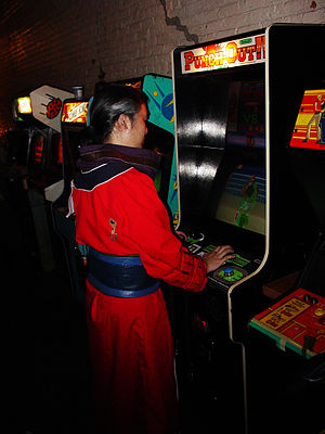 Punch-Out!! (arcade game) - An arcade patron playing the arcade version of Punch-Out!!