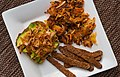 Avocado kimchi toast, tempeh bacon, and root vegetable hash browns.jpg