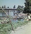 Az 1981-ben felrobbantott szigeti híd, előtérben a Huzovics-féle kikötő a Sugovica (Kamarás-Duna). Fortepan 76731.jpg