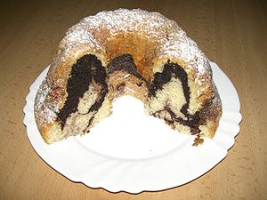 "Gugelhupf - A two-colored Czech version called ""Bábovka"". The dark brown portions of the crumb contain cocoa."