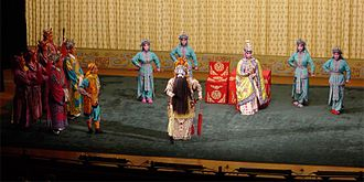 Peking opera - Farewell My Concubine, one piece of classical Peking opera. The woman, Consort Yu,  deeply loved the King Xiang Yu (middle of the stage), and when he failed in a war, she committed suicide for him.