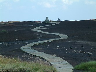The Ramblers - The paved surface of the Pennine Way on Black Hill