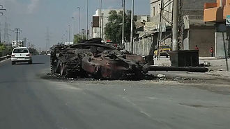 Battle of Aleppo (2012–2016) - A destroyed government tank on a road in Aleppo