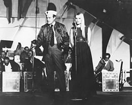 Bob Hope with Eva Rueber-Staier during USO tour on USS Saratoga (CVA-60) 1969.jpg
