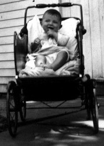 Boy in baby buggy, 1935