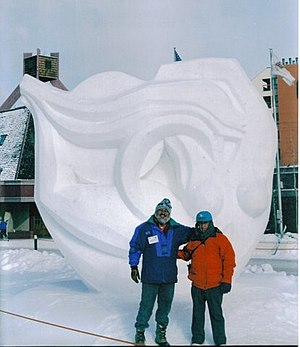 Snow sculpture - Mexican sculptor Abel Ramírez Águilar posing with a piece he created in Breckenridge, Colorado