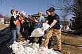 Brent Durensky, right, with the Fargo, N.D., fire department, helps volunteers during flood control efforts in Fargo April 26, 2013 130426-Z-WA217-338.jpg