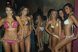 Bikini variants - String bikini-wearing models pose during a swimsuit competition