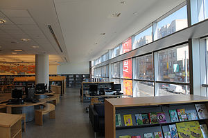 Bronx Library Center - View of the second floor children's library with curtain wall and light shelf