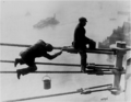 Brooklyn Bridge painters at work high above New York City, on 03 December 1915.png