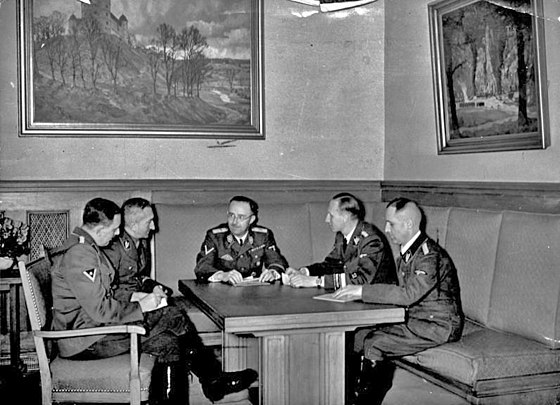 Left to right: Franz Josef Huber, Arthur Nebe, and the three planners of most of Operation Himmler: Heinrich Himmler, Reinhard Heydrich, Heinrich Müller