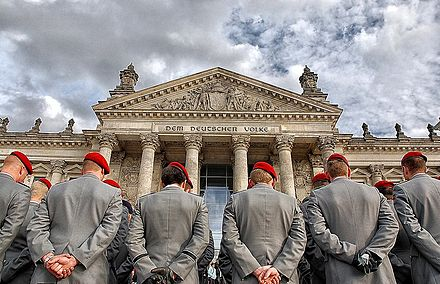 New recruits standing in front of the Reichstag building, before taking the Bundeswehr oath. Due to its infamous history of the 20th century, and before Prussian militarism; Germany of today puts a strong emphasis on having armed forces compatible with a parliamentary system. Bundeswehr Reichstag Dem Deutschen Volke.jpg
