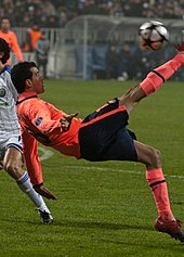 A player in midair. He is looking at the ball  his leg is moving 7f800c79bba1