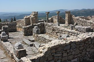 Illyrians - Details of the late antique cathedral complex in Byllis, Albania and the Adriatic sea in the distance.
