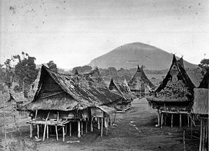 Karo people (Indonesia) - Traditional longhouses at a Karo village near Lake Toba, circa 1870.