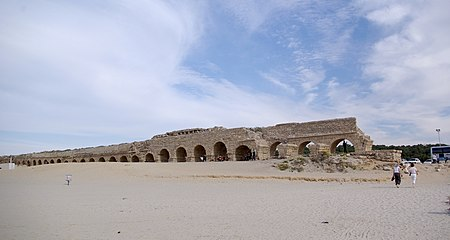 The Roman aqueduct at Caesaria Maritima, bringing water from the wetter Carmel mountains to the settlement. Caesarea maritima BW 3.JPG