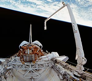 Canadian Space Agency - Canadarm (right) during Space Shuttle mission STS-72