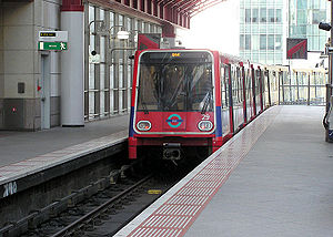 Medium-capacity rail system - A Docklands Light Railway train leaving Canary Wharf DLR station heading for Bank DLR station in central London