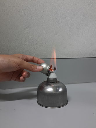 Alcohol burner - The burner's flame is capped like a candle to extinguish it.
