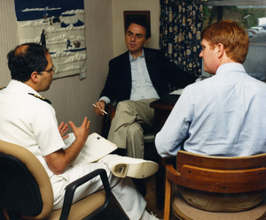 Carl Sagan (center) speaks with CDC employees ...