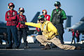 Catapult officer on USS Harry S. Truman (CVN-75) giving launch signal in 2013.JPG