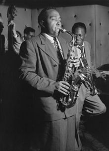 Alto sax player Charlie Parker was a leading performer and composer of the bebop era. He is pictured here with Tommy Potter, Max Roach and Miles Davis at the Three Deuces club in New York City