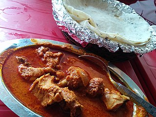 Chicken curry South Asian and Southeast Asian curry that consists of chicken stewed in an onion and tomato-based sauce, flavored with ginger, garlic, mango chutney, tomato puree, chili peppers and a variety of spice