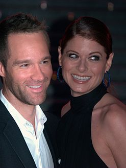 Chris Diamantopoulos and Debra Messing at the 2009 Tribeca Film Festival.jpg